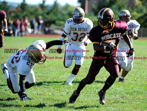 10/2/2010 Mike Orazzi | Staff New Britain's Garrett Shaw (22) and South Windsor's Jordan Jones (7) at SHS on Saturday.