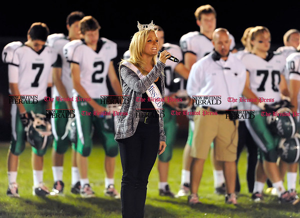 10/8/2010 Mike Orazzi | Staff Miss Connecticut Brittany Decker sings the national anthem during the opening ceremony Friday night's Bristol Eastern Northwest Catholic football game under the lights at Eastern.