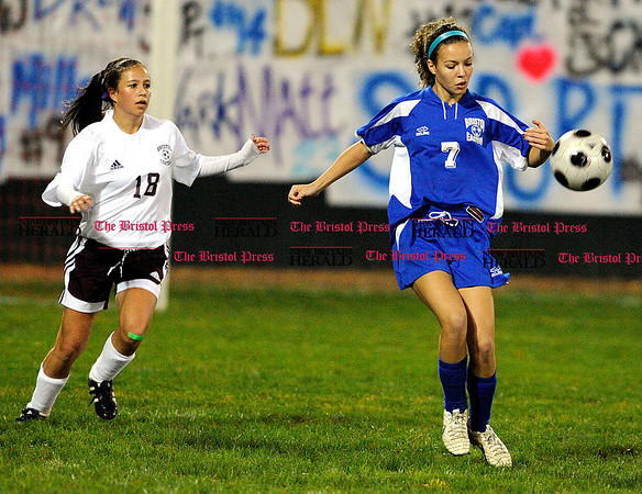 10/7/2010 Mike Orazzi | Staff Bristol Central's Samantha Redman (18) and Bristol Eastern's Aubrie Soucy (7) at Muzzy Field on Friday night.
