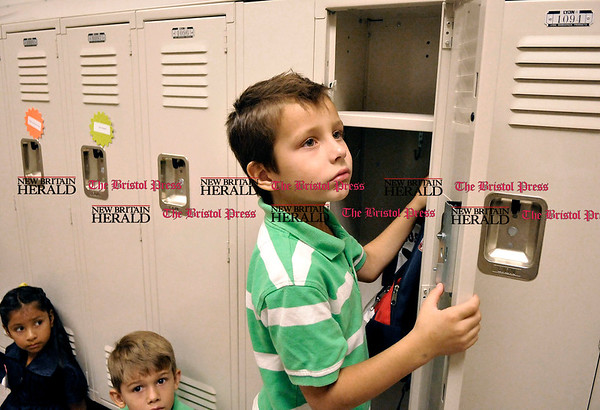 9/1/2010 Mike Orazzi | Staff Linden Street school student Jack Burgess learns how to put his backpack into his locker during the first day of school in Plainville on Wednesday morning.