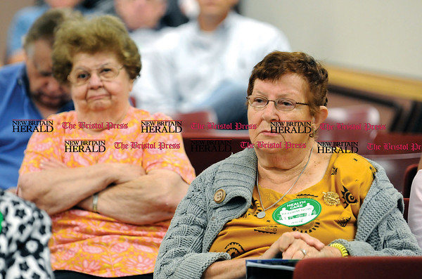 9/3/2009 Mike Orazzi | Staff Philomena Chiodo and Rita Cefaratti, both of New Britain listen to Fifth District Democratic Congressman Chris Murphy's health care forum at Council 4 AFSCME in New Britain on Thursday morning.