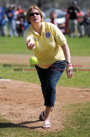 4/18/2009 Mike Orazzi | Staff Mary Ellen Holden, Little League District 5 Administrator throws out the first softball pitch during opening day for the New Britain Little League in Stanley Quarter Park on Saturday morning.