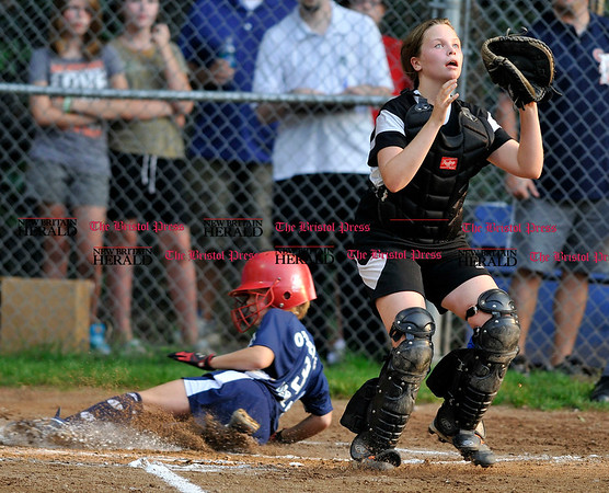 9/2/2010 Mike Orazzi | Staff Tigers' Jen Tabbacco scores as the Mets' Shelly Sadnstrom waits for the ball during the City Series final game at McCabe Waters Little League on Thursday night.