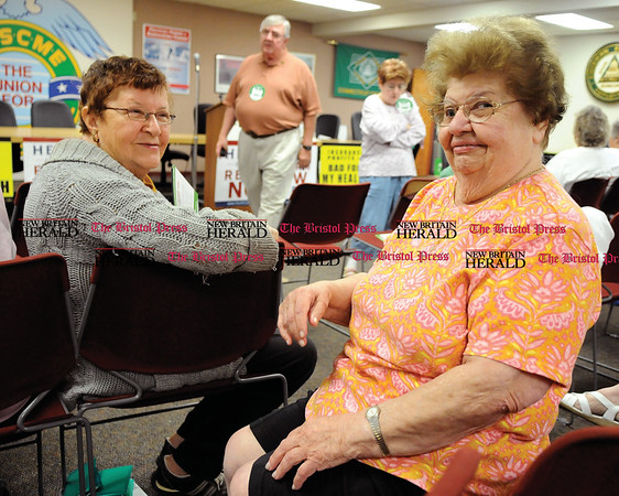 9/3/2009 Mike Orazzi | Staff Rita Cefaratti and Philomena Chiodo, both of New Britain listen to Fifth District Democratic Congressman Chris Murphy's health care forum at Council 4 AFSCME in New Britain on Thursday morning.