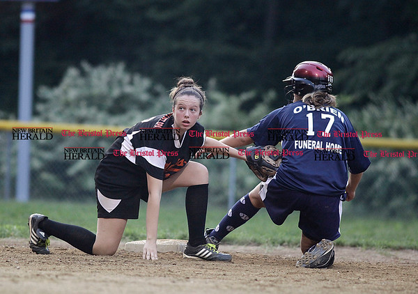 Chris Richie | Staff The Met's Caleigh Losito looks for the call as Nicole Baral of the Tigers come up safe at second during the little league softball cahmpionship in Bristol. (9/1/10)