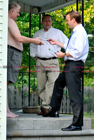 9/1/2010 Mike Orazzi | Staff STAND ALONE U.S. Congressman Chris Murphy (right) and Plainville Town Councilman Chris Wazorko talk with Trumbull Ave. resident Conrad Fongemie while going door to door in Plainville on Wednesday evening.