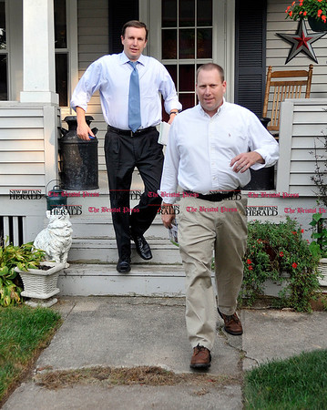 9/1/2010 Mike Orazzi | Staff STAND ALONE U.S. Congressman Chris Murphy (left) and Plainville Town Councilman Chris Wazorko (right) while going door to door on Trumbull Avenue in Plainville on Wednesday evening.