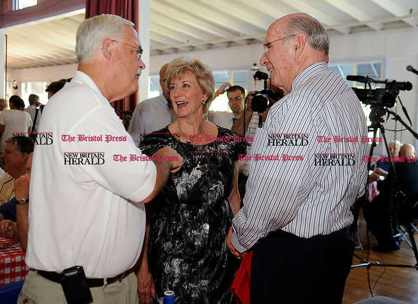 8/31/2010 Mike Orazzi | Staff Linda McMahon (center) talks with Whit Betts and Wally Barnes while at the Crocodile Club, at Lake Compounce on Tuesday.