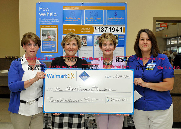 9/1/2010 Mike Orazzi | Staff Walmart Southington's Beth Egliskis (left) and Bristol Walmart Terry Kerski (right) present a $2500 check to the Main Street Community Foudation's Susan Sadecki and Jan Neri while at the Walmart store in Bristol on Wednesday. Not photographed was Kathy Reinhard.