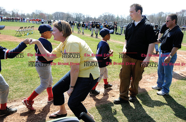4/18/2009 Mike Orazzi | Staff Mary Ellen Holden, Little League District 5 Administrator; Matthew Cannata , president of the New Britain Little League and New Britain Mayor Tim Stewart greet players during opening day for the New Britain Little League in Stanley Quarter Park on Saturday morning.
