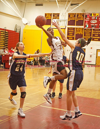 Chris Richie | Staff Nyjah Porcher puts up a shot in the New Britain girls basketball game at home against Simsbury. (2/11/11)