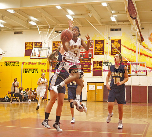 Chris Richie | Staff Nyjah Porcher goes up for a shot in the New Britain girls basketball game at home against Simsbury. (2/11/11)