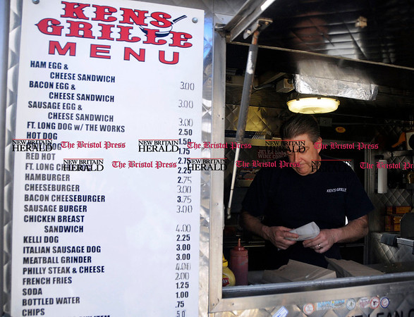 2/10/2011 Mike Orazzi | Staff Street vendor Ken Meehan of Ken's Grille on North Main Street in Bristol on Thursday.