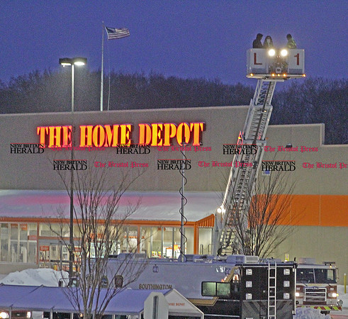 Samantha Burr Southington fire fighters inspect the roof of The Home Depot at 1816 Meriden Waterbury Tpke. on Tuesday night in Southington. (2/1/11)