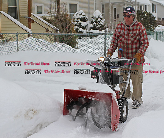 Samantha Burr Ray Lambert of Bristol snowblows the sidewalk in front of his house on Tulip Street for his neighbors. (2/1/11)