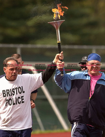 5/10/2008 Mike Orazzi | The Bristol Press Bristol Police Sgt. Jack Michaud carries the Special Olympics torch with Tri-Town athlete David Blakeslee at Northwest Regional Games' opening ceremonies on Saturday morning at Bristol Eastern High School.