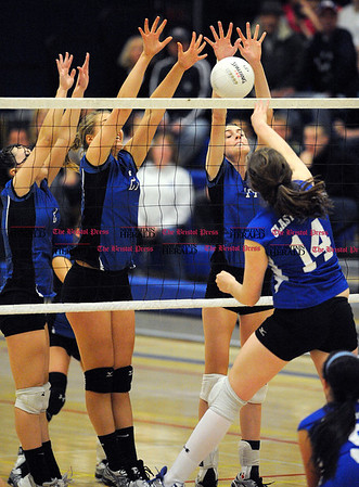 11/6/2010 Mike Orazzi | Staff Southington's Danielle Kaminsky (2) Emily Sherwill (27) and Victoria Broytman (17) during the CCC volleyball tournament at Plainville High School on Saturday night.
