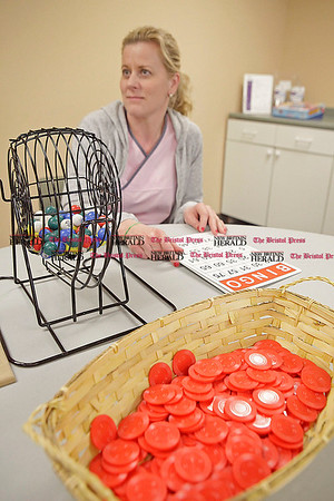 Chris Richie | Staff Activites coordinator Hanna Stolstajner CNA, prepares to play bingo with seniors at the Mulberry Gardens at Marian Heights adult day center. (1/6/11)