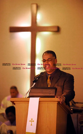 1/1/2011 Mike Orazzi | Staff Rev. Dale I. Shaw says the opening prayer during the New Britain Branch NAACP Emancipation Day Program at the Spottswood A.M.E. Zion Church in New Britain on Saturday.