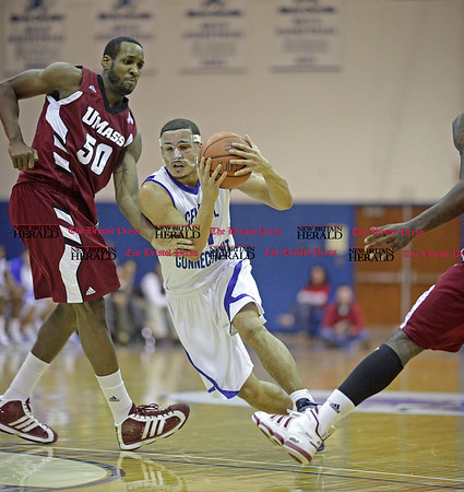 Chris Richie | Staff Shemik Thompson with the ball during the CCSU mens basketball game at home versus UMass. (1/3/11)
