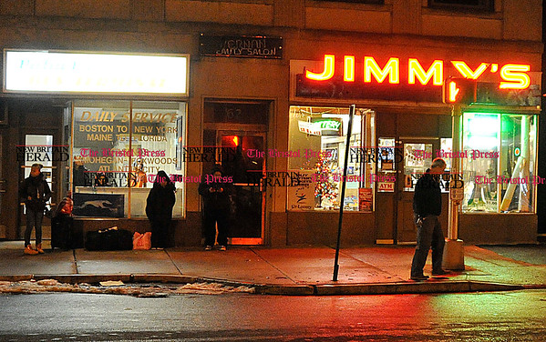 Rob Heyl Bus riders wait in front of Jimmys with its new sign. A landmark in downtown New Britain the new owner Rashmi Patel wants the &quote;same old feel&quote; as the old store but with improvments. 01.02.11 for 01.03.11
