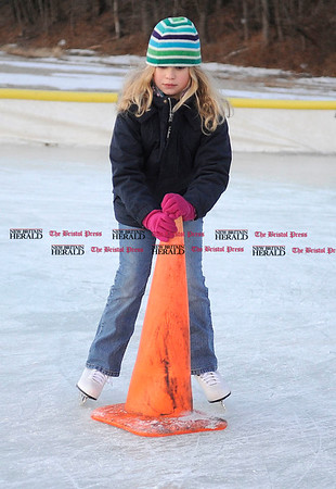1/6/2011 Mike Orazzi | Staff Ashley DeLuco,8, of New Britain skates at the downtown rink in Depot Square on Thursday evening.