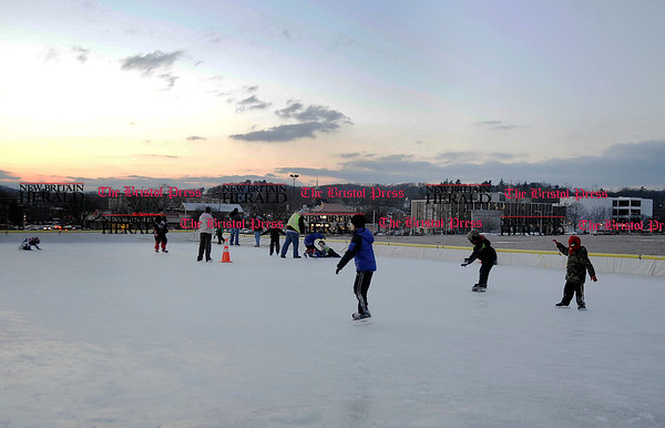 1/6/2011 Mike Orazzi | Staff Ice skaters at the downtown rink in Depot Square on Thursday evening in Bristol.