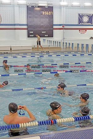 Chris Richie | Staff Swimmers warm up before a meet utilizing the new scoreboard and timing system at the Plainville High School pool. (1/4/11)
