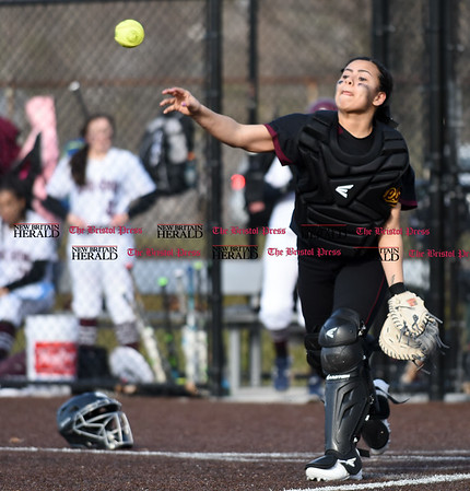 040317 Wesley Bunnell | Staff New Britain softball vs Bristol Central at Chesley Park in New Britain on Monday April 3, 2017. The game was scheduled to be played at Bristol but changed to New Britain due to field conditions with Bristol playing as the home team. New Britain catcher Christina Velaquez (3) throws down the 3rd base.