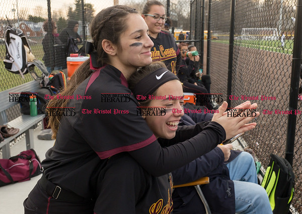 040317 Wesley Bunnell | Staff New Britain softball vs Bristol Central at Chesley Park in New Britain on Monday April 3, 2017. The game was scheduled to be played at Bristol but changed to New Britain due to field conditions with Bristol playing as the home team. Amanda Jacobs (5), left, and Paola Bronner (7) between innings.