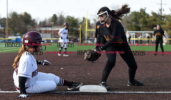 040317 Wesley Bunnell | Staff New Britain softball vs Bristol Central at Chesley Park in New Britain on Monday April 3, 2017. The game was scheduled to be played at Bristol but changed to New Britain due to field conditions with Bristol playing as the home team. BC's Maria Santilli (18) is safe at 3rd ahead of the tag by New Britain's Amanda Jacobs (5).