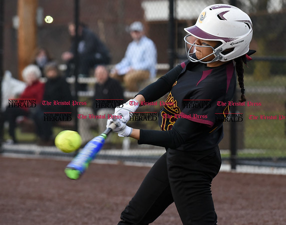 040317 Wesley Bunnell | Staff New Britain softball vs Bristol Central at Chesley Park in New Britain on Monday April 3, 2017. The game was scheduled to be played at Bristol but changed to New Britain due to field conditions with Bristol playing as the home team. Nariely Andujar (12) with a hard hit ball.