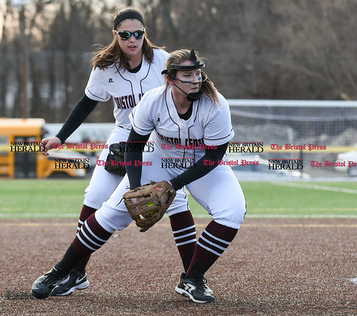 040317 Wesley Bunnell | Staff New Britain softball vs Bristol Central at Chesley Park in New Britain on Monday April 3, 2017. The game was scheduled to be played at Bristol but changed to New Britain due to field conditions with Bristol playing as the home team. Ali Holden (7) fields a ground ball back to the mound.