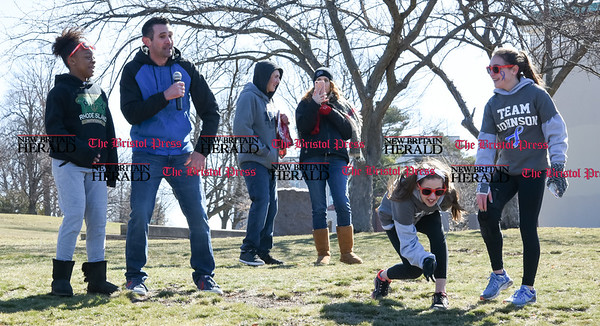 040217 Wesley Bunnell | Staff Team Johnson Walk took place on Sunday April 2, 2017 in Walnut Hill Park. 100% of the proceeds collected are being donated to the Fight Colorectal Cancer Foundation. The walk was organized by Caroline Johnson, wife of New Britain Firefighter Scott Johnson, who is currently being treated for the disease. Dancing to Uptown Funk is from left, Rozalynn Smith, DJ and firefighter Sean Crawford with Sound Direct, Natalie Reeves, kneeling, and Kaylah Schnitzer.
