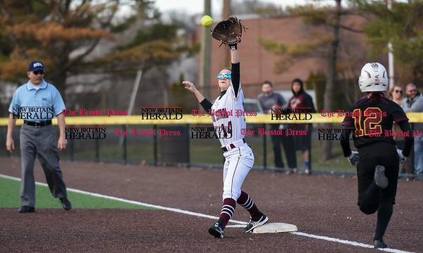 040317 Wesley Bunnell | Staff New Britain softball vs Bristol Central at Chesley Park in New Britain on Monday April 3, 2017. The game was scheduled to be played at Bristol but changed to New Britain due to field conditions with Bristol playing as the home team. Kayla Beaulieu (14) stretches to receive the throw to force the runner.