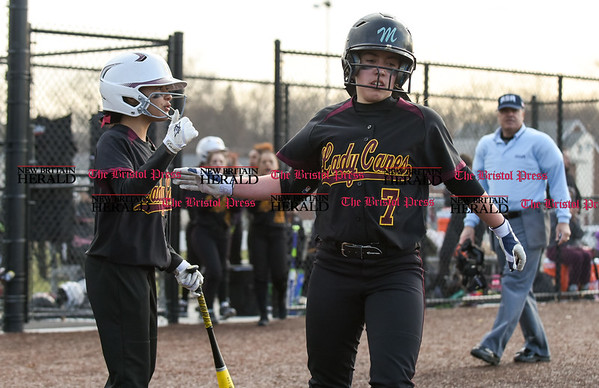040317 Wesley Bunnell | Staff New Britain softball vs Bristol Central at Chesley Park in New Britain on Monday April 3, 2017. The game was scheduled to be played at Bristol but changed to New Britain due to field conditions with Bristol playing as the home team. Paola Bronner (7) is congratulated after scoring a run.