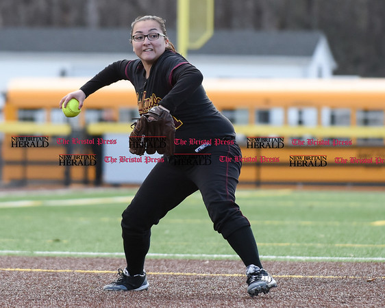 040317 Wesley Bunnell | Staff New Britain softball vs Bristol Central at Chesley Park in New Britain on Monday April 3, 2017. The game was scheduled to be played at Bristol but changed to New Britain due to field conditions with Bristol playing as the home team. New Britain shortstop Gabriella Roy (11) fields and throws to first.