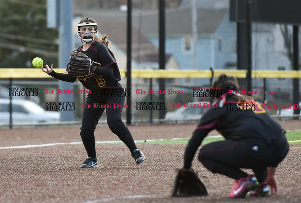 040317 Wesley Bunnell | Staff New Britain softball vs Bristol Central at Chesley Park in New Britain on Monday April 3, 2017. The game was scheduled to be played at Bristol but changed to New Britain due to field conditions with Bristol playing as the home team. Amanda Jacobs (5) is unable to get a handle on a ground ball to third.