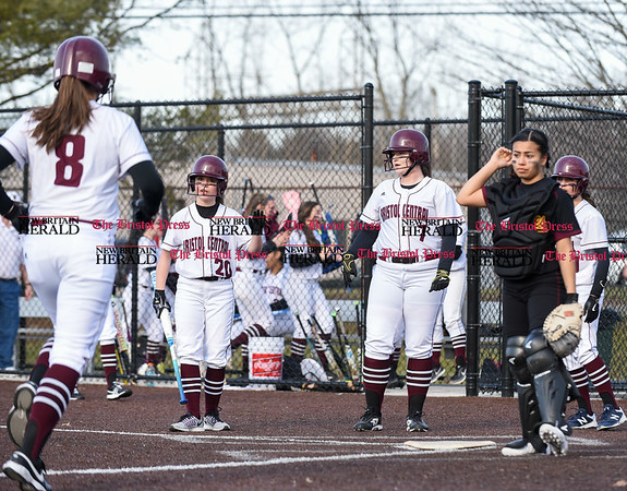 040317 Wesley Bunnell | Staff New Britain softball vs Bristol Central at Chesley Park in New Britain on Monday April 3, 2017. The game was scheduled to be played at Bristol but changed to New Britain due to field conditions with Bristol playing as the home team. Sarah Strilkauskas (8) is greeted by teammates Jenna Ptak (20) and Ali Holden (7) after hitting a home run.
