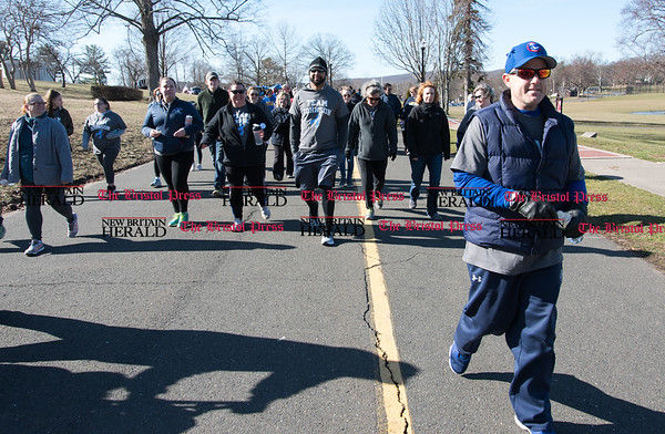 040217 Wesley Bunnell | Staff Team Johnson Walk took place on Sunday April 2, 2017 in Walnut Hill Park. 100% of the proceeds collected are being donated to the Fight Colorectal Cancer Foundation. The walk was organized by Caroline Johnson, wife of New Britain Firefighter Scott Johnson, who is currently being treated for the disease. Scott Johnson, right, leading the walkers at the beginning of the event.