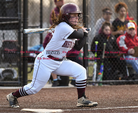 040317 Wesley Bunnell | Staff New Britain softball vs Bristol Central at Chesley Park in New Britain on Monday April 3, 2017. The game was scheduled to be played at Bristol but changed to New Britain due to field conditions with Bristol playing as the home team. Caitlyn Pacitto (15) in her follow through.