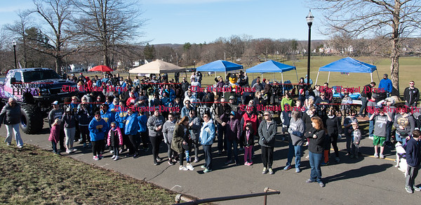 040217 Wesley Bunnell | Staff Team Johnson Walk took place on Sunday April 2, 2017 in Walnut Hill Park. 100% of the proceeds collected are being donated to the Fight Colorectal Cancer Foundation. The walk was organized by Caroline Johnson, wife of New Britain Firefighter Scott Johnson, who is currently being treated for the disease. The crowed gathers just prior to the race to listen to opening remarks by Caroline Johnson.