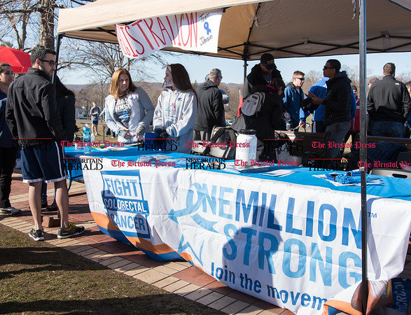 040217 Wesley Bunnell | Staff Team Johnson Walk took place on Sunday April 2, 2017 in Walnut Hill Park. 100% of the proceeds collected are being donated to the Fight Colorectal Cancer Foundation. The walk was organized by Caroline Johnson, wife of New Britain Firefighter Scott Johnson, who is currently being treated for the disease. Volunteers work the registration table.