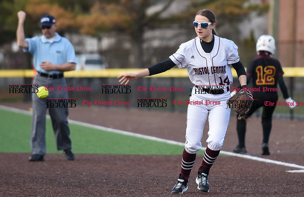 040317 Wesley Bunnell | Staff New Britain softball vs Bristol Central at Chesley Park in New Britain on Monday April 3, 2017. The game was scheduled to be played at Bristol but changed to New Britain due to field conditions with Bristol playing as the home team. Kayla Beaulieu (14) tosses the ball on the mound after an out at first base to end the inning.