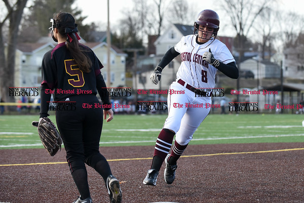 040317 Wesley Bunnell | Staff New Britain softball vs Bristol Central at Chesley Park in New Britain on Monday April 3, 2017. The game was scheduled to be played at Bristol but changed to New Britain due to field conditions with Bristol playing as the home team. Sarah Strilkauskas (8) rounds 3rd base on her way home.