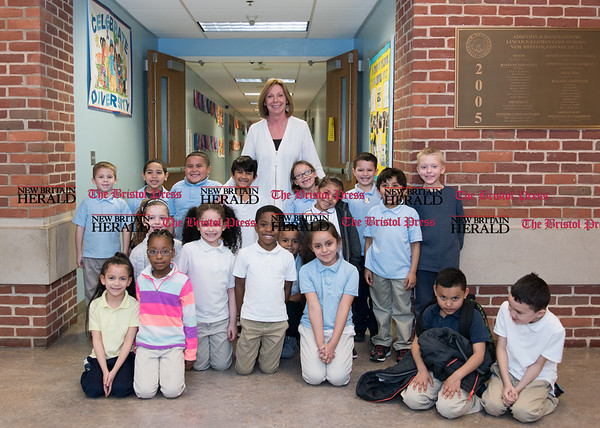 040617 Wesley Bunnell | Staff Lincoln Elementary School Principal Elaine Cabral poses for a photo with one of the first grade classes.