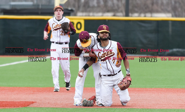 040717 Wesley Bunnell | Staff New Britain High School baseball defeated E.C. Goodwin Tech in a game played at CCSU on Friday afternoon. Josh Garcia (7) kneels in pain after tagging a runner advancing to third base.