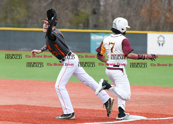 040717 Wesley Bunnell | Staff New Britain High School baseball defeated E.C. Goodwin Tech in a game played at CCSU on Friday afternoon. Josh Masterson (23) is pulled off the bag by the throw.