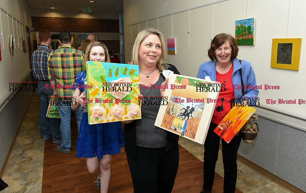 040717 Wesley Bunnell | Staff An Art of Honor Exhibition was held at The Hospital for Special Care on Friday evening. The exhibition featured art work by veterans and their families. Artist Marlo Bish gathers art work created by herself and family at the conclusion of the showing.