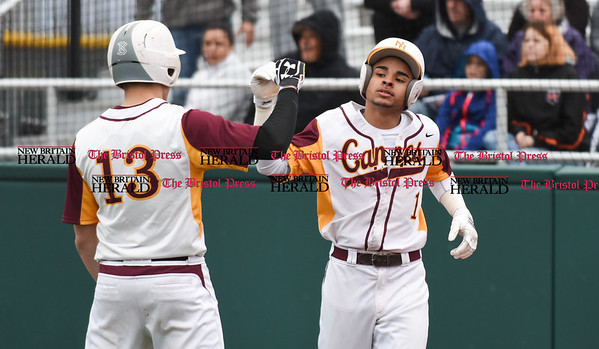 040717 Wesley Bunnell | Staff New Britain High School baseball defeated E.C. Goodwin Tech in a game played at CCSU on Friday afternoon. New Britain's Danniel Rivera (1) is congratulated by Alex Silva (12) after Rivera hits an inside the park home run.